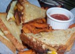 Andouille sausage grilled cheese with caramelized onions and sweet  potato fries!!!